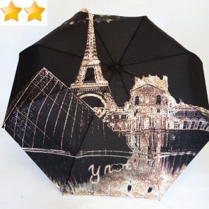 Mini parapluie open-close la nuit en ville Paris Pyramide Tour Eiffel